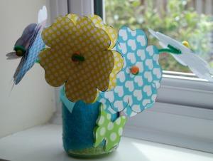 paper flower craft in butterfly jar