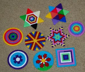 Different Hama Bead coasters made by kids on ofamilyblog