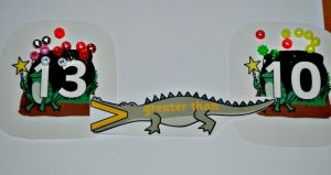 Greater than and less than crocodile with the cauldron included on maths lapbook found on ofamilyblog