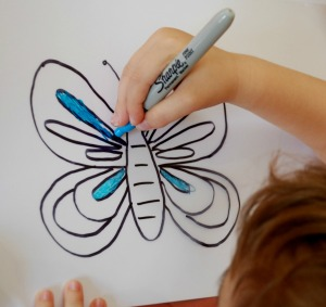 Making a laminating pouch window art, great activity for young kids
