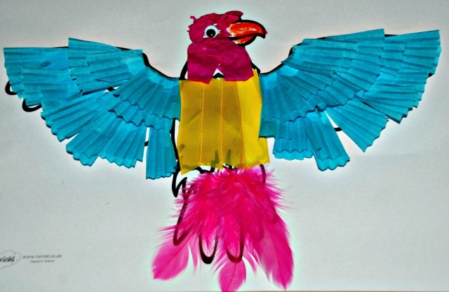 Animal collage craft made using a free to dwonload colouring pages and some basic crafting goodies