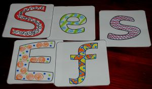 Doodle pattern alphabet tiles from Activity Village