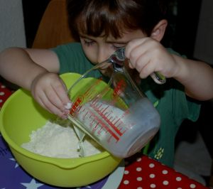 Helping with the pouring when making scones