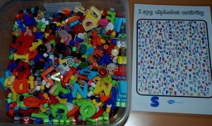 Using the I spy alphabet activity with a letter sensory tub found on ofamilyblog