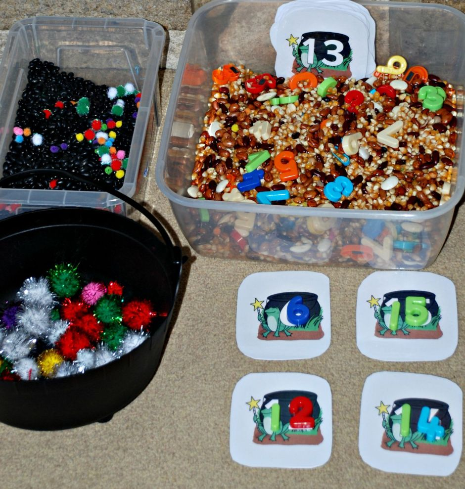 Using the Free to download numbered cauldron cards with some sensory tubs for basic counting and maths practice
