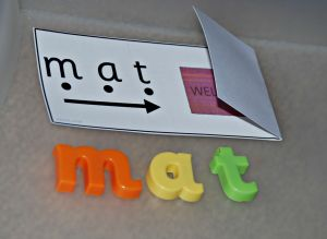 Read and reveal cards with some magnetic letters