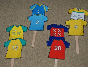 Rugby Tops from Twinkl attached to craft sticks