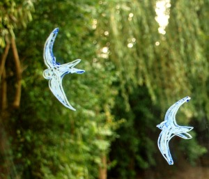 Swallows flying drawn onto a sliding door using a template from Activity village