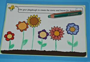 Using STABILO 3-in-1 pencils on laminated playdough mats on ofamilyblog