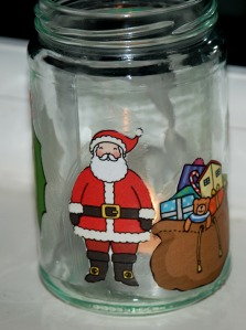 Christmas bottle with Santa and a bag full of presents