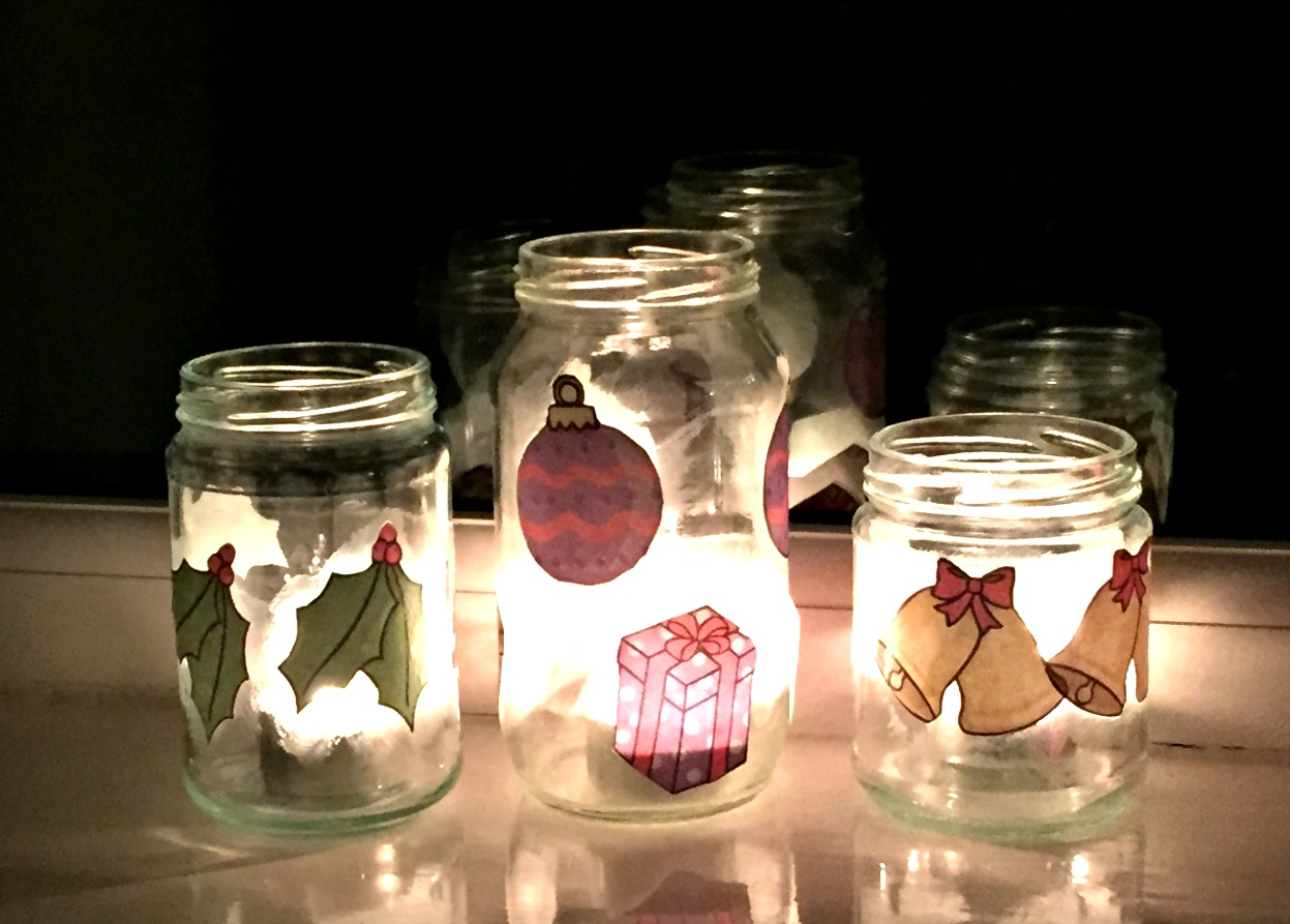 Decorating glass jars ofamily learning together for Christmas glass jars