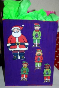 Christmas boxes - Santa and his elves using Twinkl stick puppet images