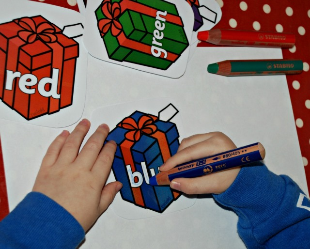 Christmas presents with the colours written on them Free from twinkl