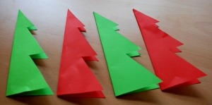 Fold the Christmas tree shapes in half before you start glueing them
