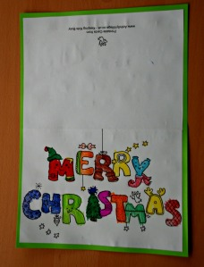 Merry Christmas colouring card stuck onto some coloured paper