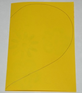 Making an envelope - fold your paper and draw a heart shape on it