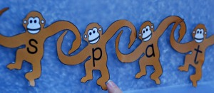 Monkey spelling using Activity village cut-outs