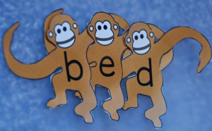 Monkeys all linked together to spell bed
