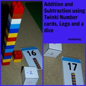 Practicing addition and subtraction using Twinkl number cards, Lego and a dice found on ofamilyblog