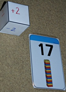 Twinkl lego cards and dice used in the addition and subtraction game on ofamilyblog