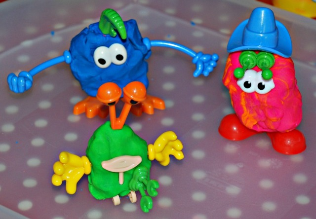 Using the plastic playdough body part set to create all kinds of little monsters