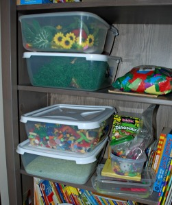 Sensory tubs stored on our bookcase for easy access