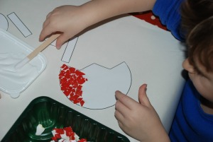 Sticking the eggshelld onto the cut-out Tulip from Activity Village