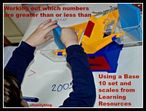 Working out which numbers are greater than or less than using a base 10 set and a scale