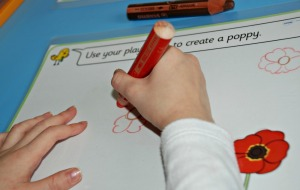 Drawing a poppy on the Twinkl play dough mat