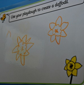 Drawing flowers on the Twinkl play dough mats