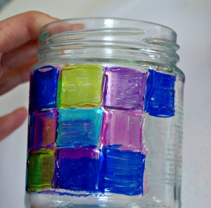 Adding glue to the sharpie pattern on your glass jar