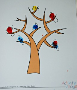 Birds on the Activity village tree page. Birds are finger painted and then details added with a felt tip pen