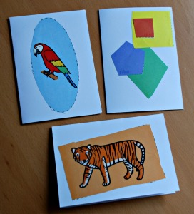 Cards made by young kids using the cutting skill pages from Twinkl