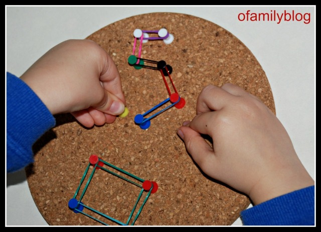Cork coasters drawing pins and loom bands to create shapes and numbers on ofamilyblog