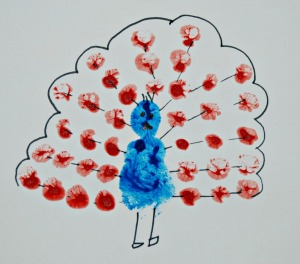 Finger painting a peacock with some details added using a felt tip pen