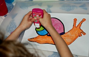 Minibeast sand art - using our pritt all purpose glue to trace over the outlines of the snail