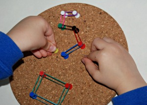 Number formation using loom bands and draiwing pins on our cork coasters