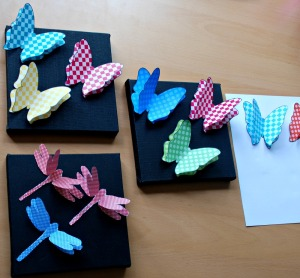 3D butterflies and 3D dragonflies on some black canvases
