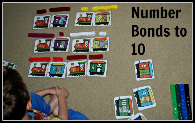 Figuring out number bonds to 10 using train cards from Twinkl and snap cubes on ofamilyblog