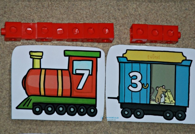 Number bond to 10 trains with snap cubes