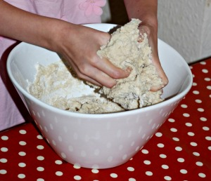 children using their hands to mix the dough