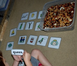 Finding a word hidden in a bean sensory tub and then matching the word to the correct picture