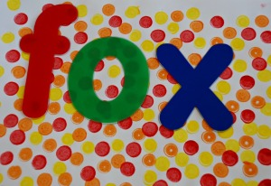 kids created their own dotty paper to use the letter stencils on