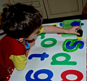 painting over the letter stencils with dabbers