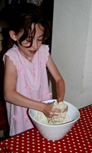 using their hands to mix the dough is a great tactile activity for children