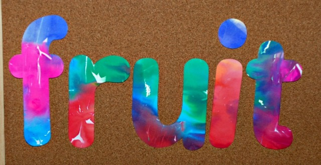word made using paper created with bleeding tissue paper and their stencils