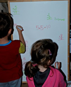 Writing out their sums on the white board