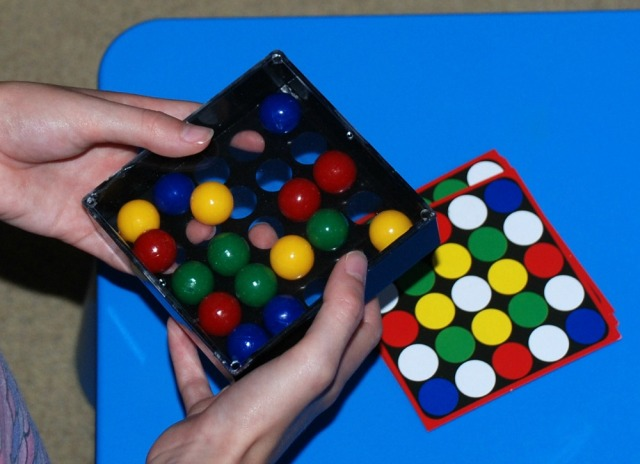 Edushape Tricky Finger game moving the coloured marbles with your fingers so it matches the pattern card