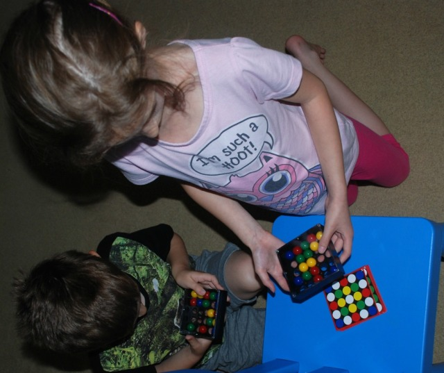 Kids playing Tricky Fingers game. Game recommended by Occupational Therapist