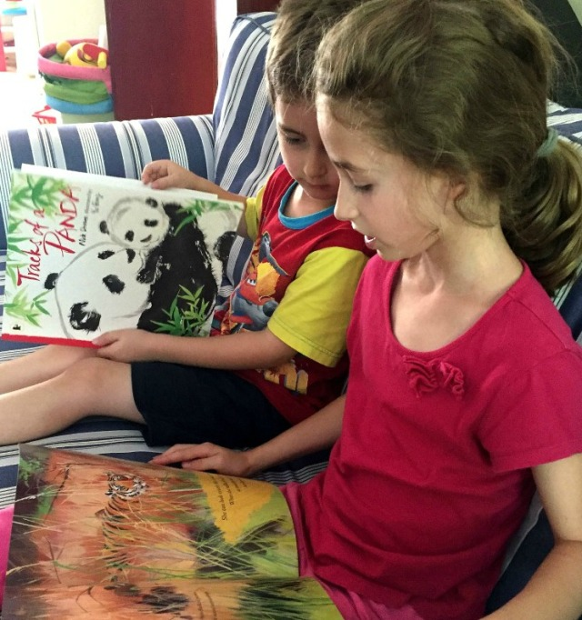 reading-their-nature-storybooks-on-the-couch-tigress-and-tracks-of-a-panda